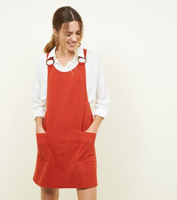 orange-round-buckle-cross-hatch-pinafore-dress